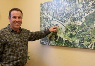 Mike Geary, general manager for Squaw Valley Public Service District, points to locations on an aerial view of the Olympic Valley aquifer during a past interview at SVPSD's office.