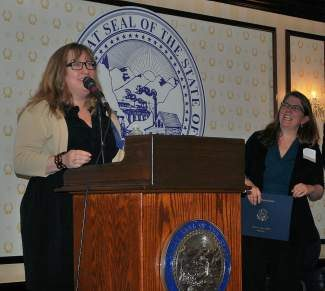 Sierra Nevada College's June Saraceno, left, accepts the Nevada award for Outstanding Teaching of Humanities during a reception March 28 at the Nevada Governor's Mansion. Christina Barr, Nevada Humanities executive director (pictured), and Thomas Fay, Nevada Humanities, Board of Trustees chair, handed out the awards.