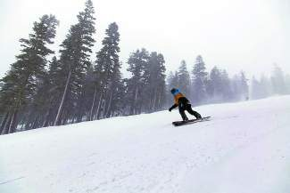 A snowboarder rides at Northstar California.