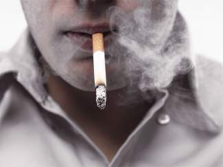 Quitting smoking is one way to help battle cholesterol.