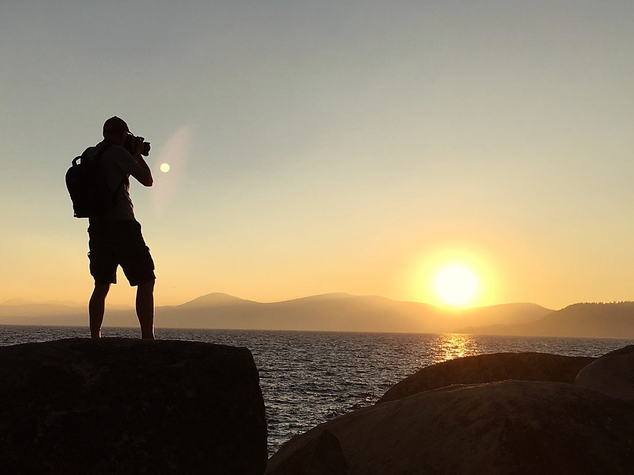 Smoky Sunset: A photographer captures a smoky Lake Tahoe from the rocks at Sand Harbor State Park on July 31.Photo: Jay Parker