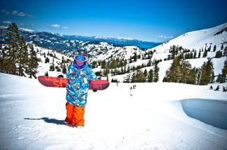A young snowboarder seen last winter at Squaw Valley. The resort, along with sister mountain Alpine Meadows, is putting millions of dollars in upgrades in this winter, some of which is aimed at new youth programs.