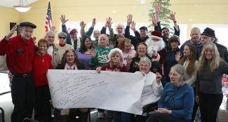 Seniors at the annual Santa Party, held at the Truckee Donner Senior Apartments, give a heartfelt thanks and hip hip hoorah to the community.