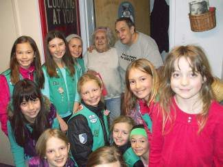 Girl Scouts deliver love and laughter at the Truckee Donner Senior Apartments.