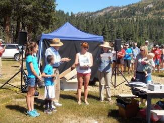 Janet Hill, daughter of Barbara Gordon — who was the first woman to swim the length of Donner Lake, in 1935 — presents the inaugural Barbara Gordon Award to Mary Short after the 33rd annual Donner Lake Swim this past Saturday. Also pictured are Vanessa and Eddie Hill, Dr. Kenneth Hall Fox, who witnessed the historic swim when he was 10, race director Laura Harsh and her daughter Ella.
