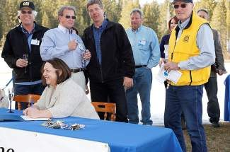 Current TCPUD directors Judy Friedman, seated, and, from left, Erik Henrikson, Ron Treabess, Dan Wilkins and Lou Reinkens sign documents transferring the Tahoe City Golf Course into the district's fold.