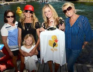 """From left: Tamara McKinney, Sherry McConkey, Ayla McConkey, Kendal Naughton and Debbie Dutton at the Truckee Duckee Derbee. A commemorative T-shirt honors Timy Dutton, professional skier and BASE jumper who died in a skydiving collision in Lodi. His nickname was """"Rubber Ducky."""""""
