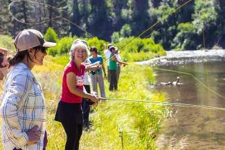 Meghan Jewett of the Truckee River TU Chapter brings some skill and smiles to the group of new fly anglers.