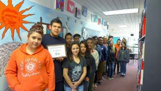 Sierra Continuation High School students and staff pose with a Model Continuation High School award that the school received recently from the California Department of Education. It's an honor the school has received since 2000.