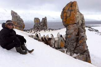 Fine art photographer Keoki Flagg captured on the other side of the lens at Chinstrap Rookery, Half Moon Bay Island, Antarctic Peninsula, Antarctica, in November 2013.
