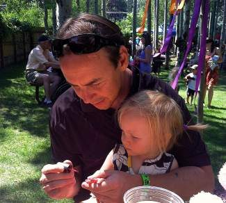 Todd Burchett paints his daughter, Anna's, fingernails during the 2012 Tahoe Teddy Bear Picnic.