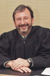 Incline Judge E. Alan Tiras was first elected to the bench in 2006 and was re-elected, without opposition, in 2012.