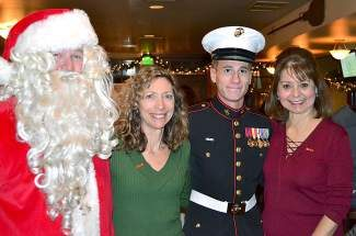 From left: Santa (Greg Parker), Mary Margaret Xifo-Rankin, U.S. Marine Corp. Parker Dial and Elaine Durazo get the holiday season rolling at a Toys for Tots event.
