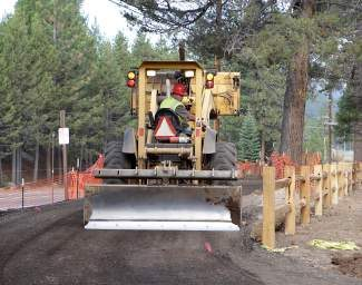 Crews work in September on the now-completed Brockway Road Trail, a paved trail between Truckee River Regional Park and The Rock commercial center.