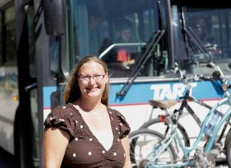 Truckee/North Tahoe Transportation Management Association's new Executive Director, Jaime Wright, stands in front of one the region's several modes of transportation.