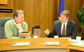 """IVGID Trustee Jim Smith, left, listens to a point made by fellow trustee Jim Hammerel at the end of Wednesday's meeting. Hammerel said he is """"happy and content with what's proposed in the ordinance."""""""