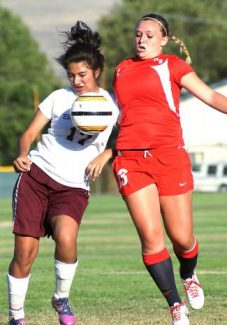 Truckee senior Kaylee Neill contends for a ball against Sparks on Friday. Neill scored two goals in the Wolverines' 5-0 win.