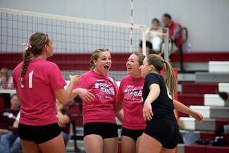 Truckee players Mackenzie Redner, Becca Berelson, Chelsea Mohun and Tori Simpson (l to r) celebrate a point on senior farewell Friday.