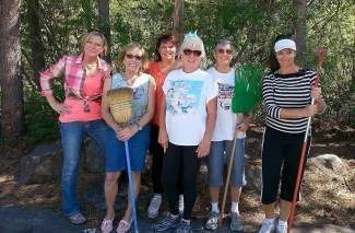 From left: Deby, Judy, Wendy, Marlon, Lynn, Susan and  Elaine (not pictured) raked in good karma at spring cleaning day.