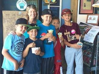 "From left: Ben Purgason, Max Ellermeyer, Jackson Ellermeyer, Tyler Rock,  and Sam Purgason ""wowed"" Whitney Hardy's mom, Molly Hardy, left of center, by bringing in their own allowances to buy treats to support Whitney's recovery."