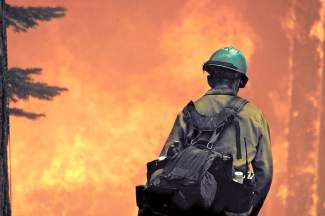 A firefighter looks on during the Washoe Fire, which consumed six homes on the West Shore during the summer of 2007. Tahoe fire officials are concerned that, with recent dought conditions, the 2014 fire season will be a busy one.