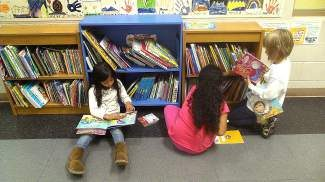 Students at IES enjoy the new Free Little Bookshelf.