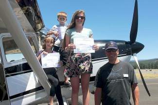 Three happy Young Eagles were presented flight certificates by their pilot  Kevin Quinn. In addition to their certificate, each Young Eagle receives a logbook in which to record their flights.