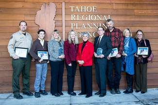 Left to right are Dan Shaw, Dylan Eichenberg, Kathy Strain, TRPA board chairwoman Shelley Aldean, Joanne Marchetta, Jeff Poulin, Ted Wendell, Cindy Gustafson and Lolly Kupec. Wendell accepted an award for his late brother, Tom, and Kupec accepted an award for Missy Mohler.