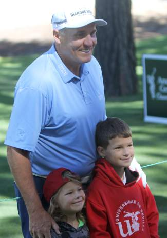 Former NFL quarterback Mark Rypien poses with fans during the Lake Tahoe Celebrity-Am on Tuesday.