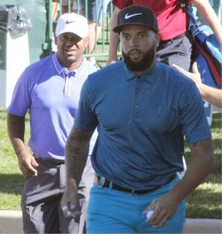 Dallas Mavericks point guard Deron Williams (front) and actor Alfonso Ribeiro make their way to the first tee from the driving range Wednesday.