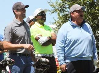 Green Bay Packers quarterback Aaron Rodgers (left), Hall of Fame receiver Jerry Rice (middle) and actor Brian Baumgartner (right) admire a tee shot on the first hole during the Lake Tahoe Celebrity-Am on Wednesday, July 20, at Edgewood Tahoe Golf Course.