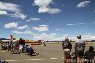 Guests lined the barrier between the crowd and the planes to get a view of the show.