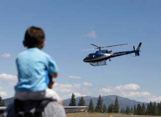 A boy watches as a CareFlight helicopter takes off during the Truckee Tahoe AirShow & Family Festival on Saturday.