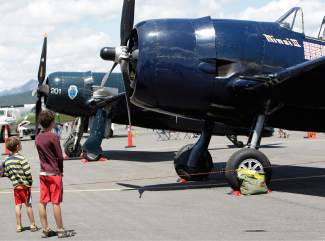 These two boys check out one of the several static displays at Truckee's air show.