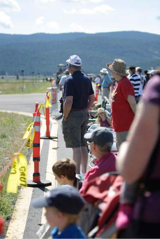 People line a runway at Truckee Tahoe Airport on Saturday to watch air performances.