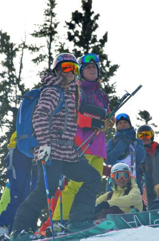 Big-mountain skier Michelle Parker of Squaw Valley (front left) watches an avy dog demonstration with ski patroler Lel Tone (front right) during the SAFE AS avalanche clinic on Dec. 19.