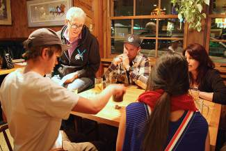 Two teams compete during the dice competition of Tuesday's Bar Olympics.