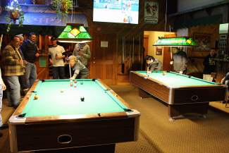 Teams compete in pool during the Bar Olympics at Pete 'n Peters in Tahoe City.