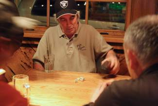 Gary Mackenzie competes in the dice event of the Bar Olympics on Tuesday.