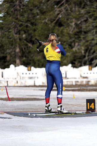 Buff Wendt shoots at targets from the standing position during Saturday's U.S. Winter Biathlon National Championships Pursuit.