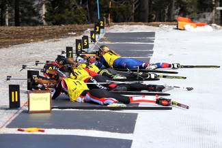 Biathletes shoot from the prone position during Saturday's U.S. Winter Biathlon National Championships at Auburn Ski Club.