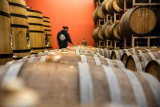 Adam Thomas, head brewer at Tahoe Mountain Brewing Co. in Truckee, gives a tour of the company's storage room of mostly whiskey, but also cognac and wine, used for barrel-aged beers.