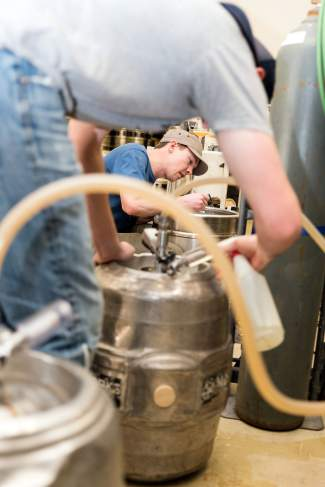 During an afternoon tasting tour in February, Matt Garcia and Kevin Drake fill the first kegs of Alibi Ale Works pale ale ever made.