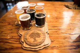 A flight of beers sits atop a Tahoe-shaped plank at Tahoe Mountain Brewing Co.'s brewpub in Tahoe City.