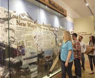 Members of the public tour Donner Memorial State Park Visitor Center's exhibits, including this one on the Washoe people, for the first time Saturday afternoon.