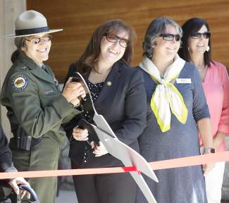 From left, Sierra District superintendent for California State Parks Marilyn Linkem; director of California State Parks Lisa Mangat; town of Truckee vice major Joan deRyk Jones; and legislative director for California Assembly Member Brian Dahle, Cheri West, team up to cut the ribbon.