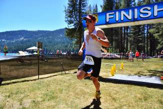Truckee's Donatas Ereminas wins the half-Ironman distance event of the Donner Lake Triathlon on Sunday.