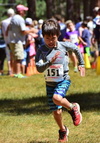Jack Schrady of Truckee digs for the finish line during the Kids 9-10 race.