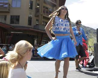 """During the annual """"Trashion Show,"""" local students showcased homemade outfits created from discarded materials, ranging from single-use plastic bags to tires."""