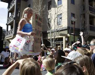 """During the """"Trashion Show,"""" audience members were encouraged to do one thing to help the enviroment, such as saving water."""